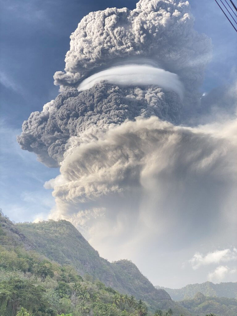This is a photograph showing the enormous grey eruption column rising 8-10km into the sky after La Soufrière's first explosive eruption.